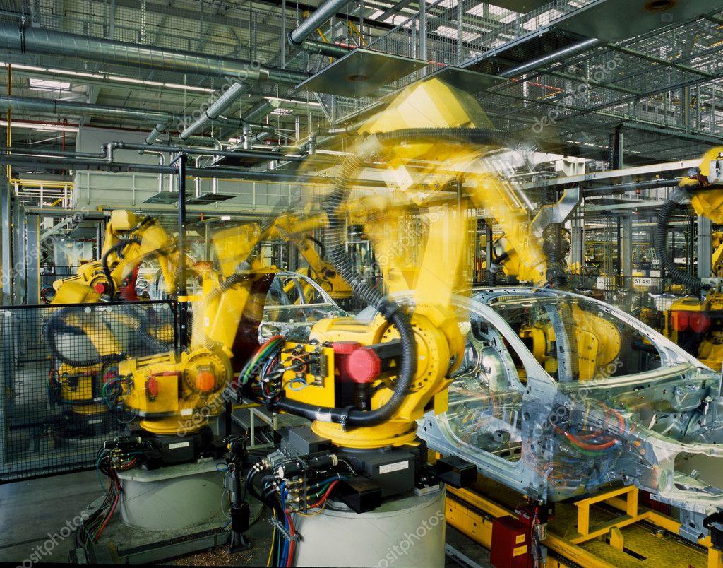 黄色机器人焊接生产线的汽车
