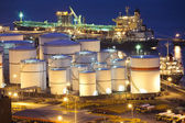 Oil tanks scene at night — Stock Photo