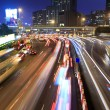 Traffic jam at night in Hong Kong - Stock Photo