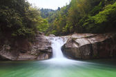 Deep forest waterfall in Wuyuan, China. — Foto de Stock