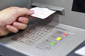 A hand taking a receipt of an Automated Teller Machine — Stock Photo