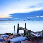 Jetty on sea at sunset — Stock Photo #26722063