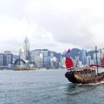 Hong Kong harbor with tourist junk boat — Stock Photo #29520725