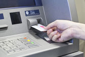 Hand taking money on ATM bank machine — Stock Photo