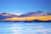 Sunset at Hong Kong downtown, facing cargo terminal. — Stock Photo