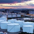 Oil and gas refinery tanks at twilight — Stock Photo