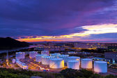 Industrial oil tanks at sunset — Stock Photo
