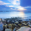 Sunset coast with sea stones background — Stock Photo