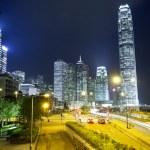 Hong Kong traffic and skyscraper offices at night — Stock Photo