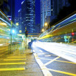 The light trails on the modern building backgrounds in Hong Kong — Stock Photo