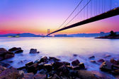 Modern bridge at coast in sunset — Stock Photo