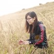 Asian woman in sunset grasses — Stock Photo
