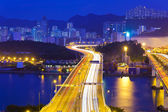 Modern highway in city at night — Stock Photo