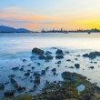Sunset along coast with sea stones — Stock Photo
