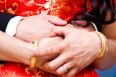 Couple holding hands in wedding day — Photo