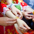 Stock Photo: Elderly relatives presenting golden bracelet as blessing i
