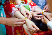 Elderly relatives presenting the golden bracelet as a blessing i — Stock Photo