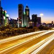 Стоковое фото: Modern city traffic at night in Hong Kong