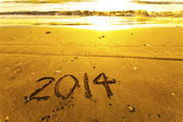 2014 words on sand — Stockfoto