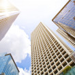 Low angle shot of modern glass city buildings — Stock Photo #44284529