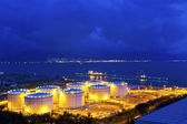 Big Industrial oil tanks in a refinery at night — Stock Photo