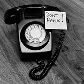 Black retro bakelite telephone — Stock Photo