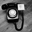 Black retro telephone with reminder note — Stock Photo #23790001