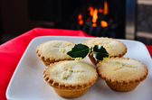 Christmas mince pies by the fire — Stock Photo