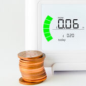 House energy meter showing the cost per hour for electricity usage — Stock Photo