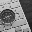Keyboard with compass black and white — Stock Photo