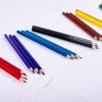 Color pencils diagonalno lie on three pieces — Stock Photo #19544377