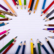 Color pencils creating circle imitation — Stock Photo