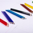 Color pencils diagonalno lie on three pieces — Stock Photo #19544377