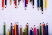Color pencils creating a chaotic frame — Stock Photo