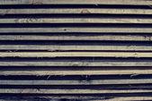 Horizontally lying wooden old bars — Stock Photo