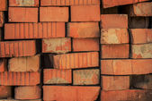 Old red bricks randomly lying — Stock Photo