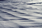 Textural background in the form of a snow field — Stock Photo
