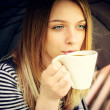 Womanl drinks fragrant coffee with pleasure under umbrella — Foto Stock