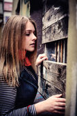 Curious woman looking in uncertainty of darkness — Stock Photo