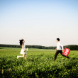 Romantic couple of lovers in field runs towards each other — Stock Photo #38218491