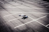 Loving young pair at wedding on an empty autoparking — Stock Photo