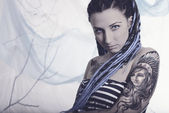 Young beautiful woman with tattoo and dreadlocks — Stock fotografie
