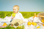 Happy child with candy and picnic — Stock Photo