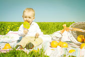 Happy child with candy and picnic — Stok fotoğraf