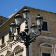 Valencia, Spain. Streetlight against buildings — Stock Photo