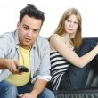 图库照片: Teenage couple on sofa