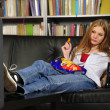 Teenage girl on the sofa — Stock Photo