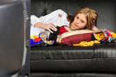 Teenage girl on the sofa — Stok fotoğraf