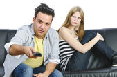 Teenage couple on the sofa — Stock Photo