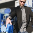 Young man with convertible at gas station — Stock Photo
